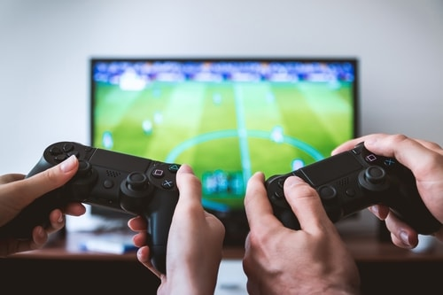 Couple playing video game in living room