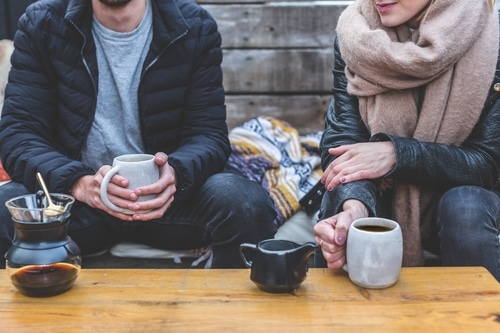 Couple sitting together talking about their day over coffee