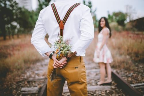 Man giving flowers to his girlfriend