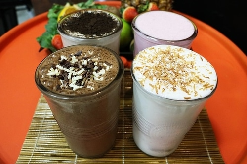 4 different flavored milkshakes on a table