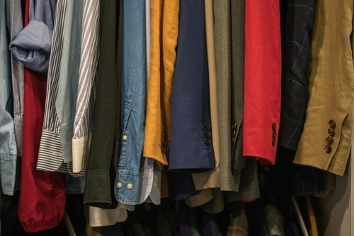 Row of shirts, coats, and jackets in a thrift shop